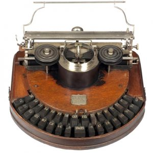 Photograph of the Hammond 1 mahogany typewriter.