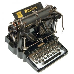 Photograph of the Sholes Visible typewriter.