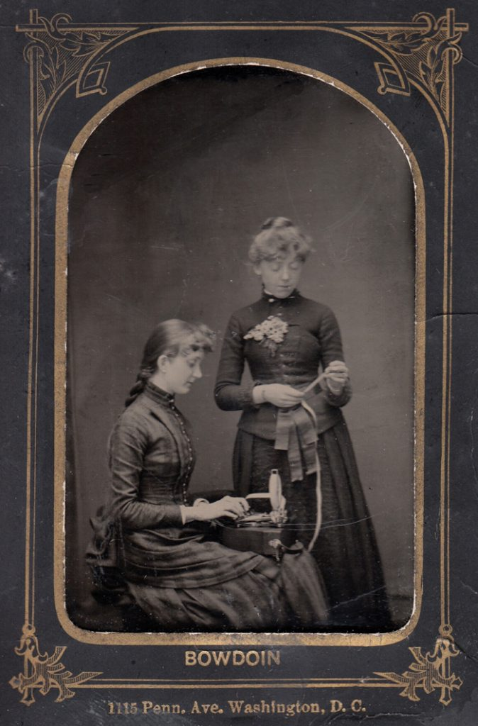 Period studio photo of two women posing with a Stenograph 1 2nd form, dated 1886.