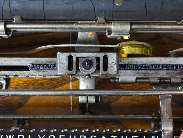 Photograph of the Merrett typewriter showing the printing point under the carriage.