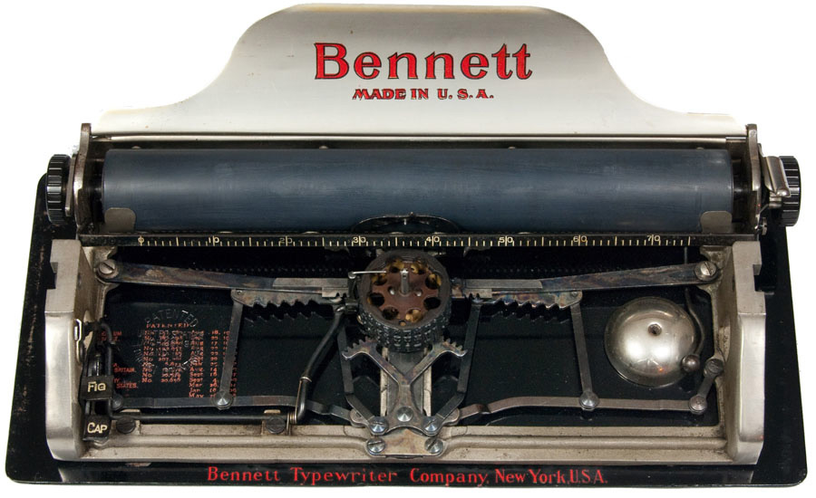 Photograph of the Bennett typewriter with the keyboard removed showing the inner mechanisms.
