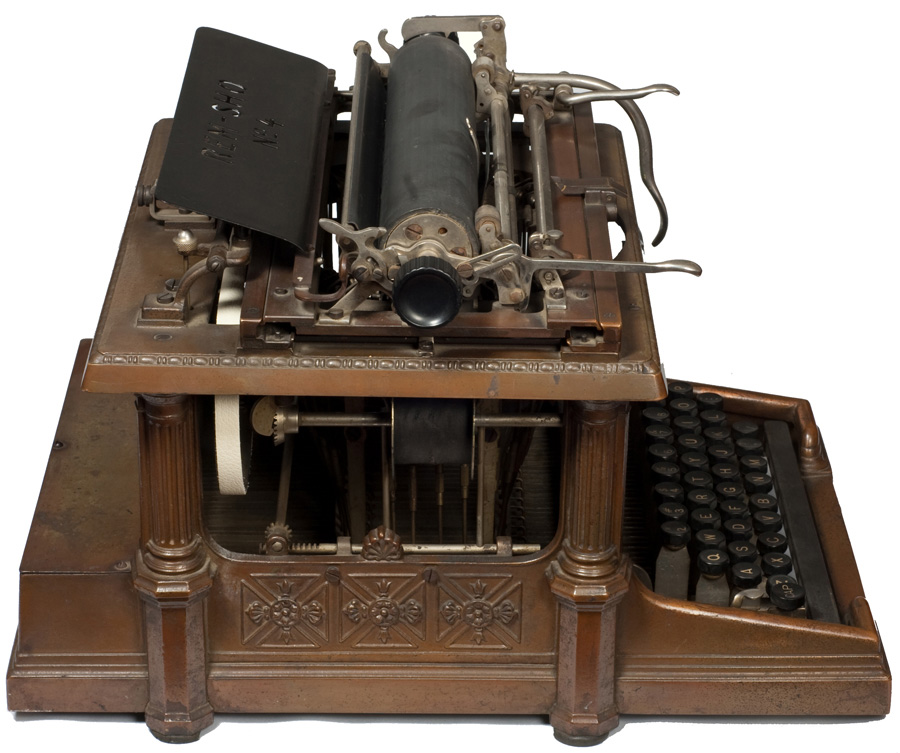 Photograph of the Rem-Sho 4 typewriter from the left hand side.
