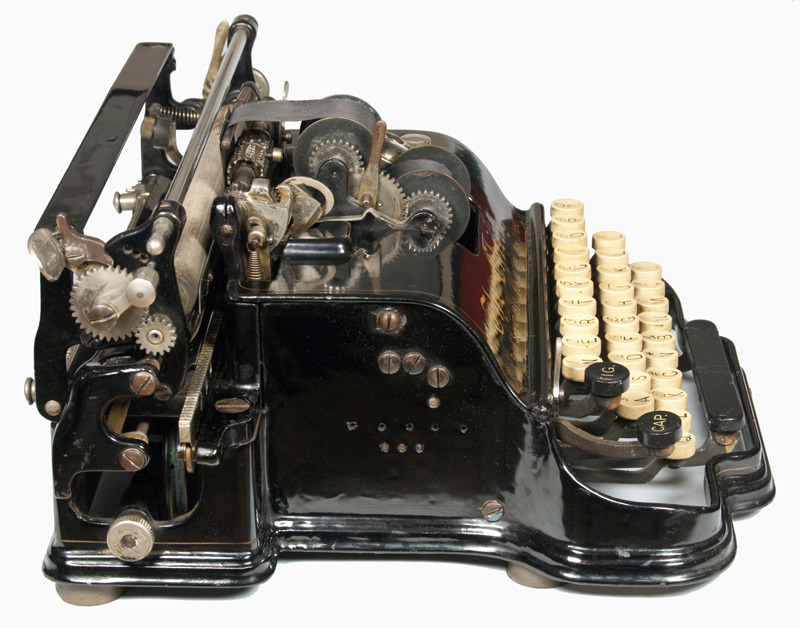 Photograph of the Chicago 1 typewriter from the left hand side.