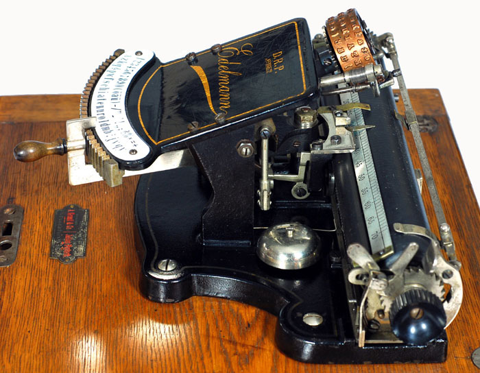Photograph of the Edlelmann typewriter from the left hand side.