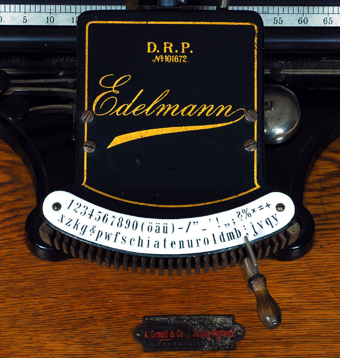 Photograph of the Edlelmann typewriter showing a close up of the top plate.