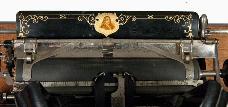 Photograph of the Franklin 9 typewriter showing a close up of the carriage and paper table.