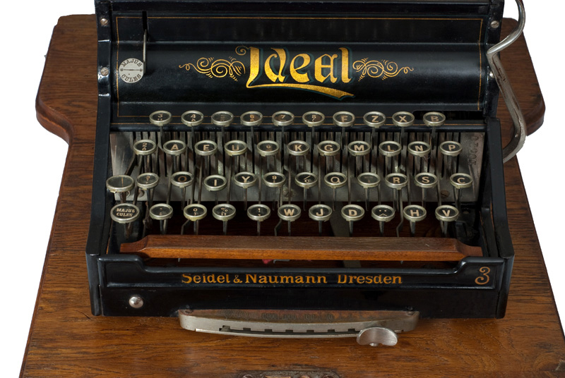 Photograph of the Ideal typewriter showing the front view.