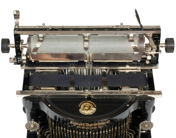 Photograph of the Jewett 4 typewriter with the carriage in the up position.
