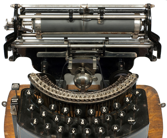 Photograph of the National 2 typewriter with the carriage in the up position.
