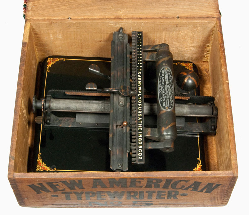Photograph of the New American 5 typewriter in its box with the lid off.