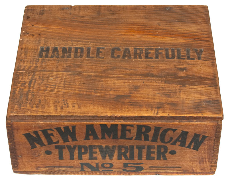 Photograph of the New American 5 typewriter dovetailed wooded box.