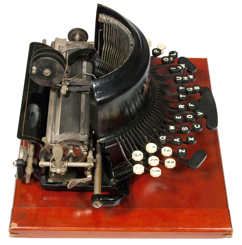 Photograph of the Franklin - New Model typewriter from the left hand side.