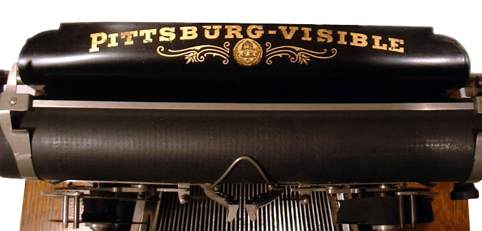 Photograph of the Pittsburg Visible typewriter showing a close up of the paper table.