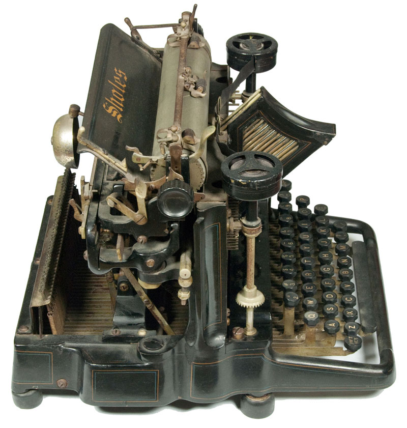 Photograph of the Sholes Visible 1 typewriter showing the left hand side.