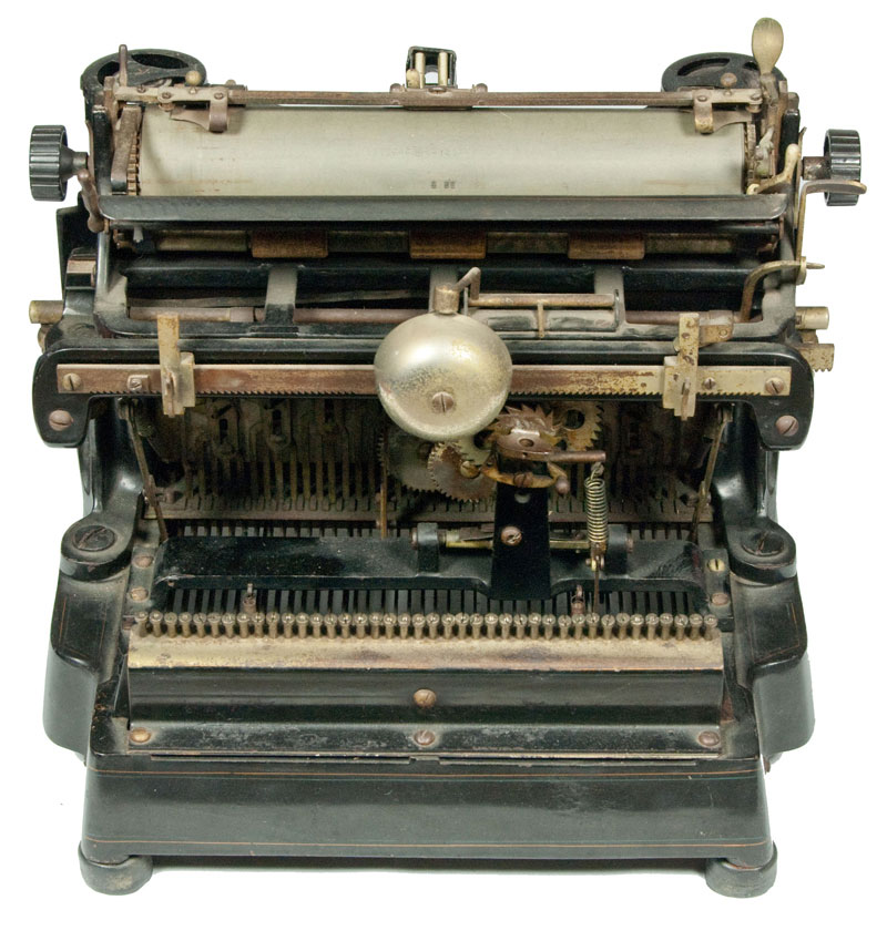 Photograph of the Sholes Visible 1 typewriter showing the back view.