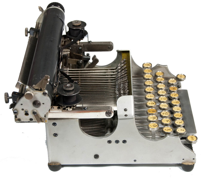 Photograph of the Standard Folding 1 typewriter from the left hand side.