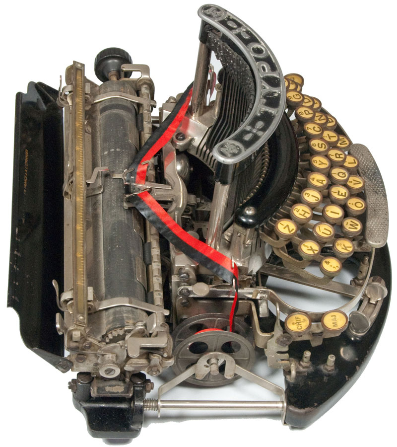Photograph of the TYPO typewriter from the left hand side.