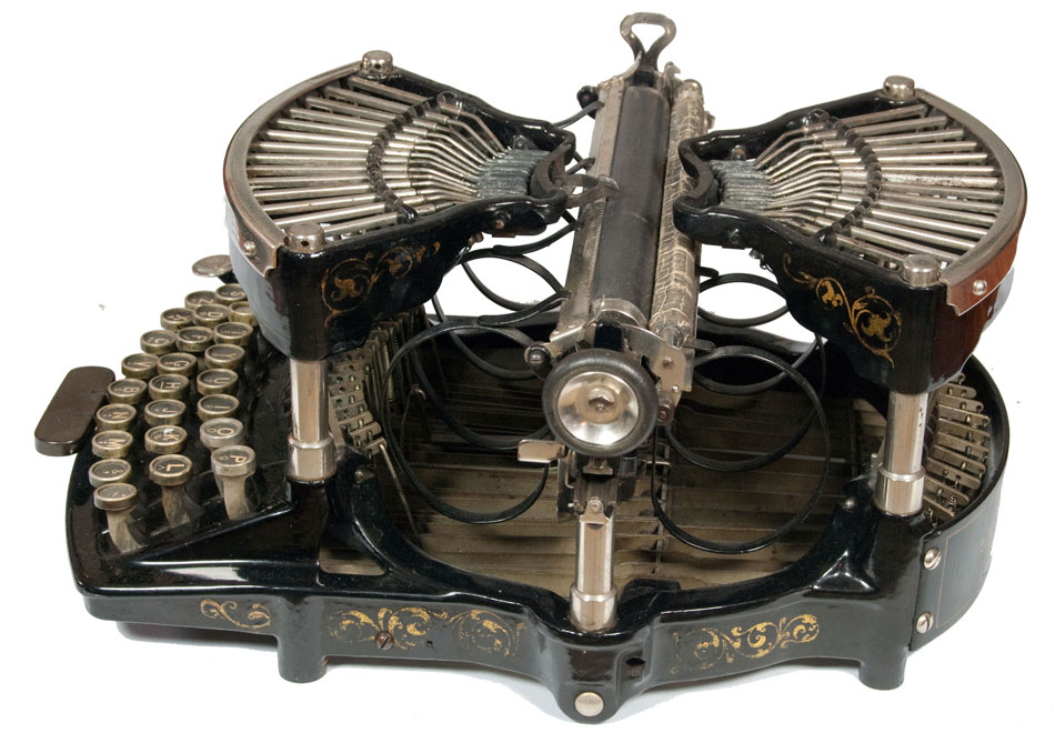 Photograph of the Williams 1 typewriter from the right hand side.