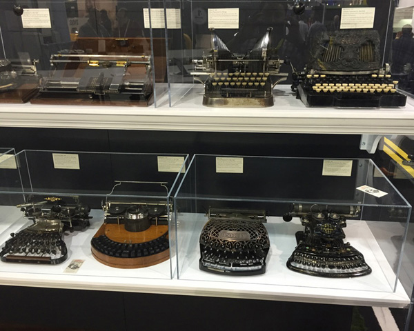 A photograph showing a display of Martin Howard's antique typewriters at the CES.